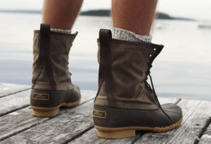 guy wearing boots on dock